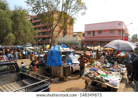 ARUSHA, TANZANIA - SEPTEMBER 10, : A bustling open air market in Arusha, Tanzania on September 10, 2012.  Local markets are open every day of the week all through out Arusha.