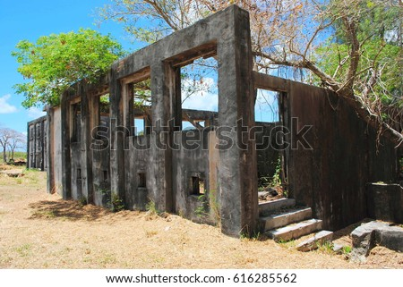 As Lito Airfield Ruins, Saipan Ruins of some structures at the As Lito airfield from the World War 11 remain as a tourist attraction near the Saipan International Airport in Saipan.  Foto stock ©