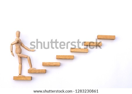 Ascending stairs and wooden man model going upward, isolated on white background.Business growth, steps to success or progress way to forward achievement concept.  #1283230861