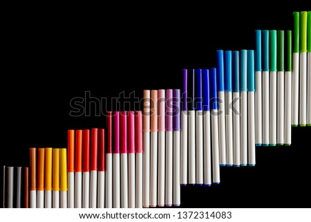 Ascending step stairs (by colorful marker pens) isolated on dark background.Encourage motivation and inspiration, business growth to success, Progression concept. #1372314083