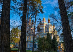 Ascension Cathedral, a Russian Orthodox cathedral located in the Panfilov Park in Almaty, Kazakhstan, built by Zenkov's design. Old, completely wooden church. Spring photography of the church.