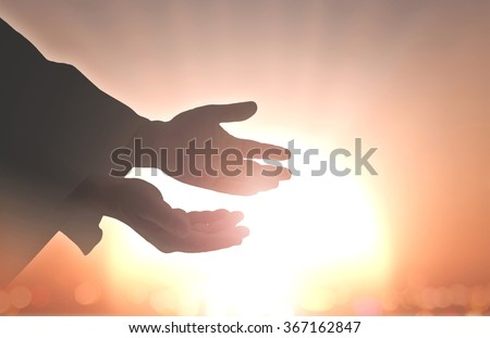 Ascension day concept: Silhouette hands of God over blurred autumn sunset background #367162847