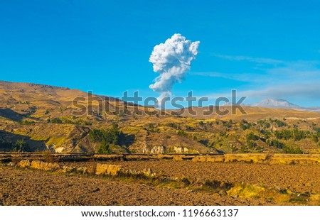 Ash clouds explosion during an eruption of the Sabancaya volcano nearby the Colca Canyon between Chicay and Arequipa, Peru.