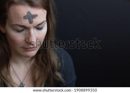 Ash cross on woman's forehead Stock photo ©