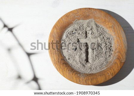 Ash wednesday, crucifix made of ash, dust as christian religion. Lent beginning Сток-фото ©