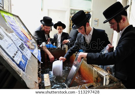 ASHDOD - APRIL 15: Ultra Orthodox Jewish men prepare for the Jewish holiday of Passover on April 15 2011 in Ashdod, Israel.