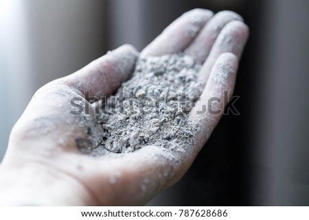 ashes in a female hand.the ash on his hands