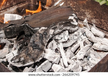 ashes in an iron box, barbecue, fire