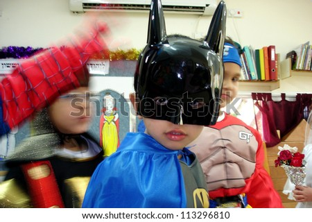 ASHKELON, ISRAEL - MARCH 02: Israeli child dressed up as batman costume during the Jewish holiday Purim in kindergarten in Ashkelon Israel.