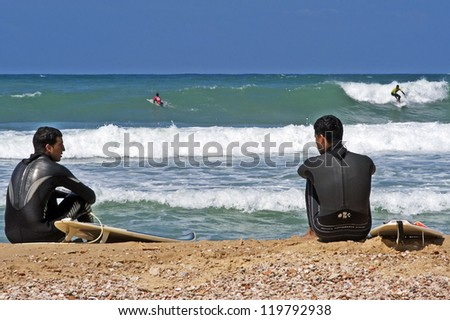 ASHKELON - OCT 09: Wave surfer surfing wave at sea on October 09 2010 in Ashkelon, Israel.It originated by Polynesian people and was first discovered by Captain Cook in 1778.