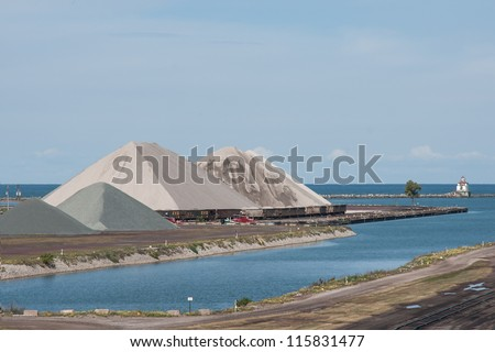 ASHTABULA, OH - SEPTEMBER 29: Massive pyramids of aggregate materials delivered by Great Lakes freighters in advance of cold weather line the harbor on September 29, 2012 at Ashtabula Ohio.