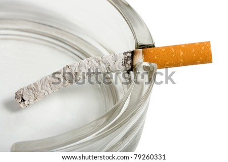 Ashtray and cigarette close-up isolated on white background