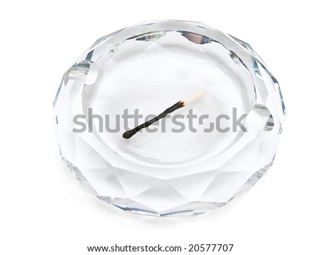 ashtray and match against the white background