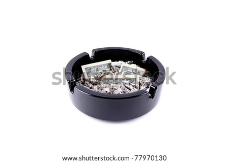 Ashtray filed tobacco ashes and burned-out money isolated over white