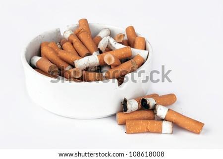 Ashtray full of cigarettes isolated on white
