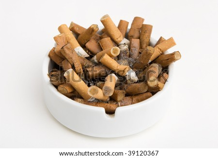 Ashtray full of cigarettes isolated on white
