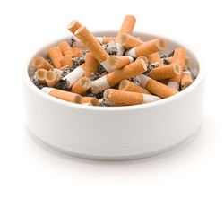 Ashtray full of smoked cigarettes isolated on white background
