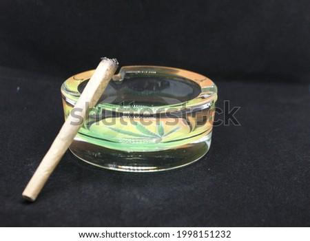 Ashtray joint weed cannabis medical hemp cbd marihuana ash black background Stockfoto ©