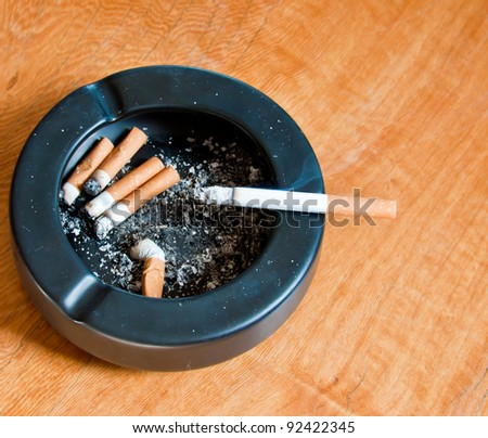 ashtray on wood table
