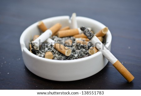 Ashtray with a cigarette butts - stock photo