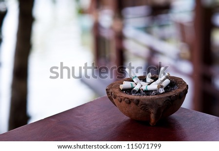 ashtray with cigarette in house