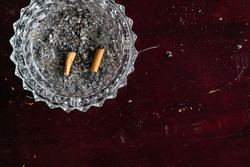 Ashtray with two cigarette butt. Negative Space. Shot from above