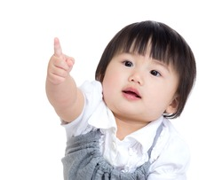 Asia baby girl finger point toward
