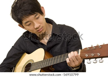 asia boy plays his guitar