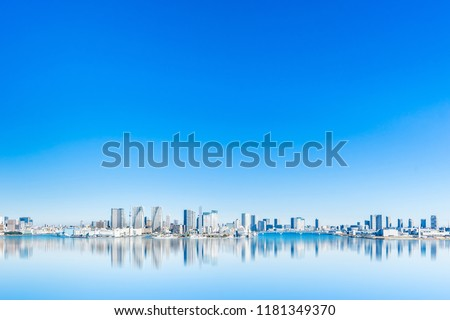 Asia Business concept for real estate and corporate construction - panoramic city skyline aerial view of tokyo bay with mirror reflection under blue sky in odaiba, Tokyo, Japan