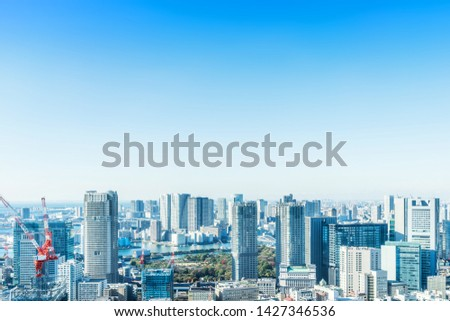 Asia Business concept for real estate and corporate construction - panoramic modern city skyline bird eye aerial view of Odaiba with crane near tokyo tower under blue sky in Tokyo, Japan stock photo