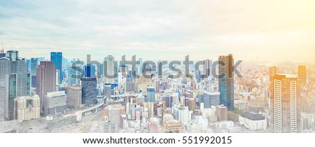 Asia Business concept for real estate - panoramic modern cityscape building bird eye aerial view under sunrise and morning blue bright sky in Osaka, Japan, mix with hand drawn sketch illustration #551992015