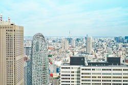 Asia Business concept for real estate - panoramic modern cityscape building bird eye aerial view of cocoon tower and skytree under sunrise and morning blue bright sky in Tokyo, Japan