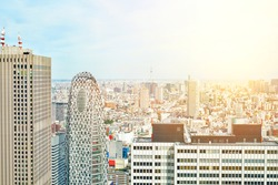 Asia Business concept for real estate - panoramic modern cityscape building bird eye aerial view of cocoon tower under sunrise and morning blue bright sky in Tokyo, Japan