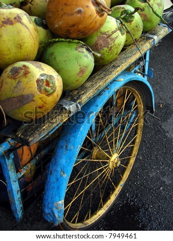 Asia concept: Tropical coconuts vendor's grunge vehicle for business