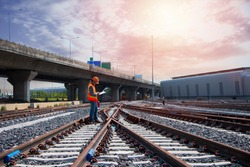 Asia construction worker on railways. Engineer work on railway with labor on background. rail, engineer, Infrastructure.