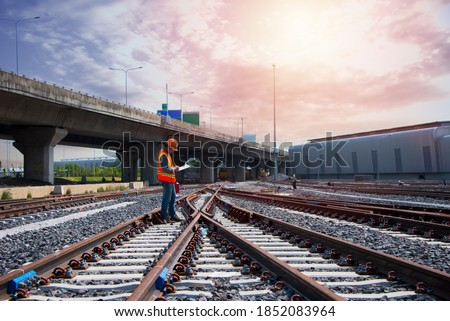Asia construction worker on railways. Engineer work on railway with labor on background. rail, engineer, Infrastructure. Сток-фото ©