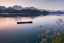 Asia culture - Beautiful landscape of lake level reflect fantasy dramatic sunrise sky in Sun Moon Lake , in Taiwan, Asia. the famous travel attractions in Nantou ,Taiwan. Scenery of Sun Moon Lake,