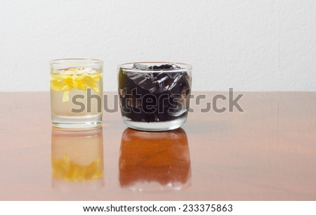 Asia dessert. grass jelly with syrup on table
