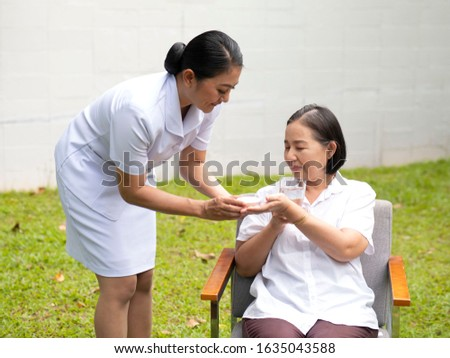 Asia elderly with nursing care at home.
