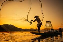 Asia Fishermen on boat fishing at lake