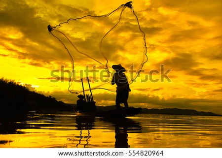 Asia Fishermen on boat fishing at lake #554820964