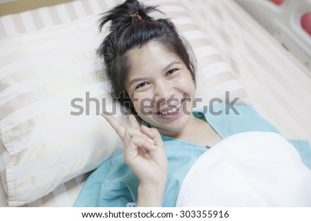Asia Girl Happy On Hospital Bed
