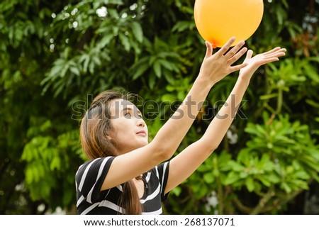 asia girl play color balloon at outdoor natural