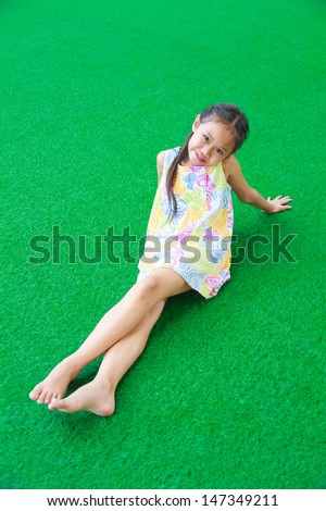 Asia girl smile happy on the grass.