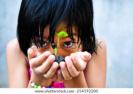 Asia girl were little planted in pots , Focus on little plant.