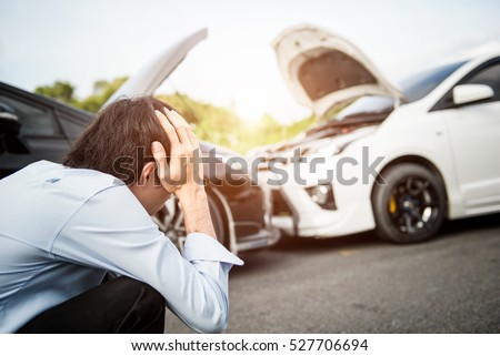 Asia man driver man in front of automobile crash car collision accident in city road.