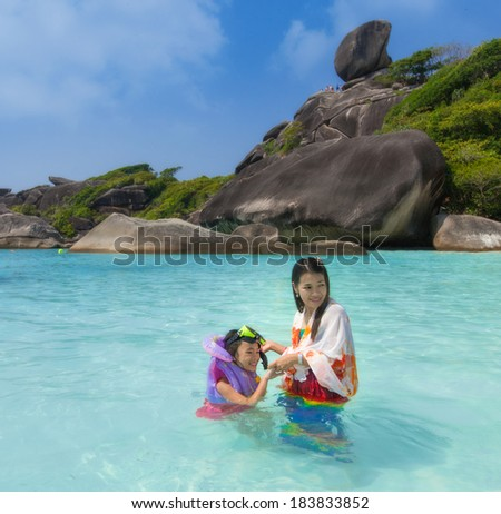 Asia mother and her daughter in Tropical beach, Similan Island, Andaman Sea, Thailand
