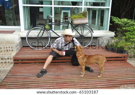 Asia Thailand Man Cowboy Sit With Dog #65103187