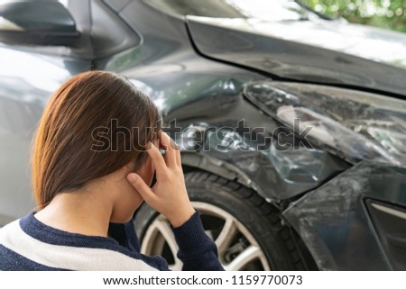Asia woman driver woman in front of automobile crash car collision accident in city road.