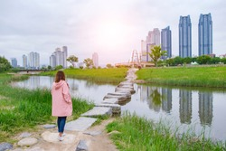 Asia woman walking at Taehwagang Grand Park at Ulsan Korea on April.